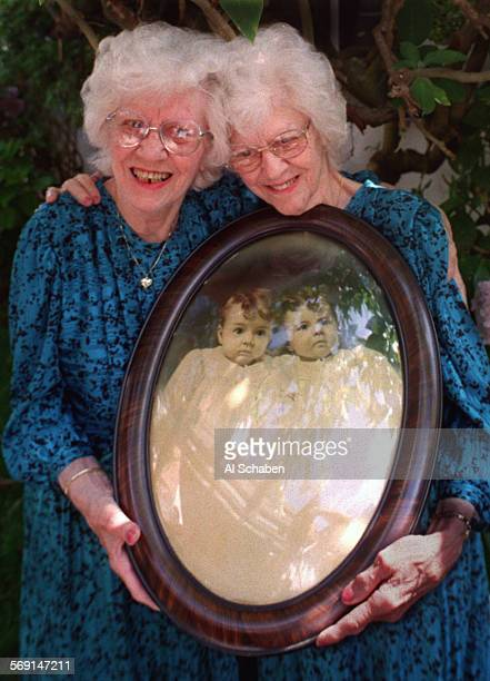 LStwinsportrait0521AS––LOS ALAMITOS––Identical twins Irene Peterson left and Ilene Eddy of Belmont Shore who both have Alzheimer's disease hold a...