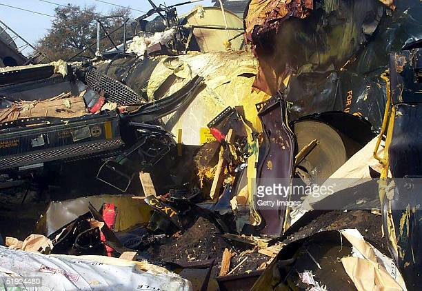 Twisted metal lies at the scene of a train collision January 6 2004 in Graniteville South Carolina in this photo released by the US Environmental...