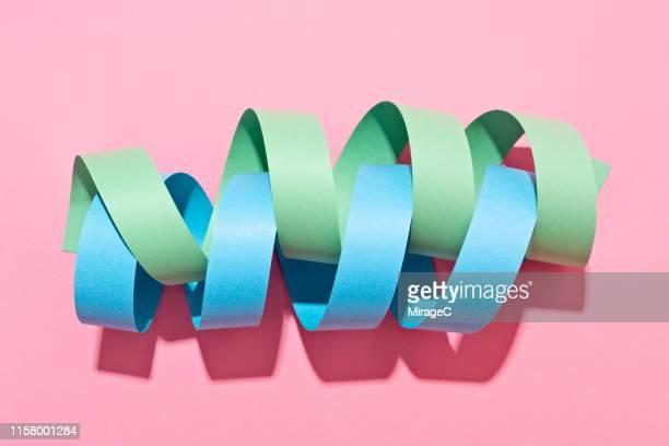 twisted paper stripe helix - verdreht stock-fotos und bilder