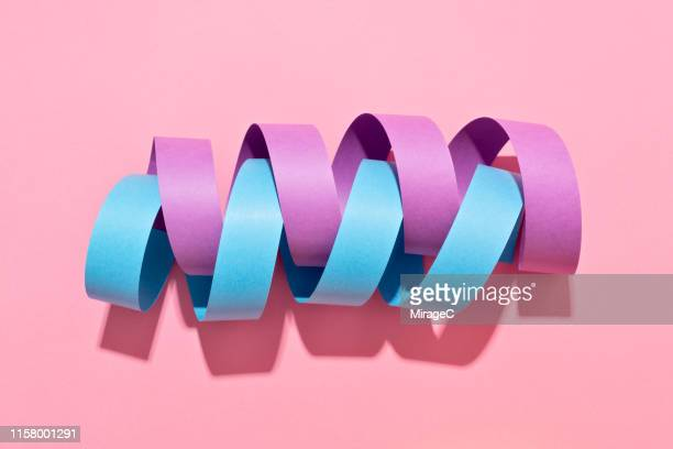 twisted paper stripe helix - togetherness stock pictures, royalty-free photos & images