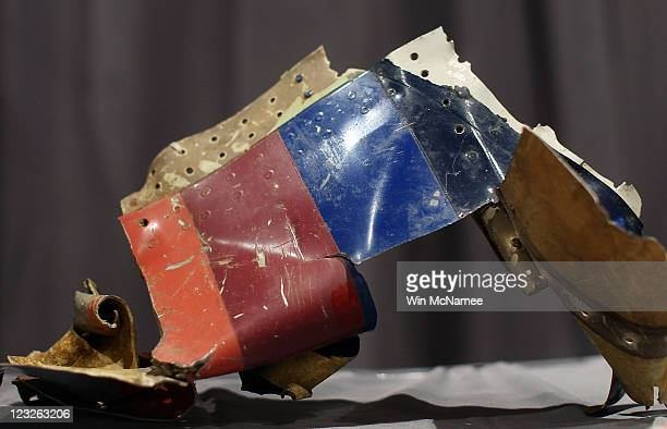 A twisted piece of the fuselage of United Flight 93 found at the crash site in Shanksville Pennsylvania is displayed alongside other artifacts from...