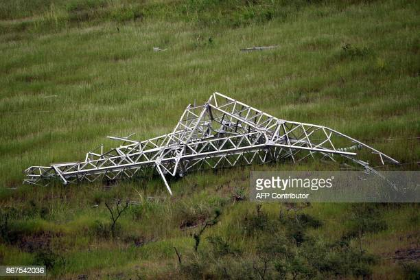 A twisted power distribution line tower is crumpled on the ground on October 28 2017 after the passing of Hurricane Maria in Guayama Puerto Rico...