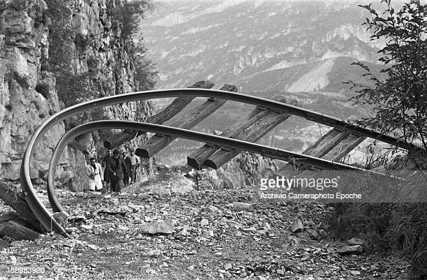 A twisted railroad track rises from the rubble Longarone near the Vajont Dam in the Piave Valley Italy early October 1963 On October 9 a landslide in...