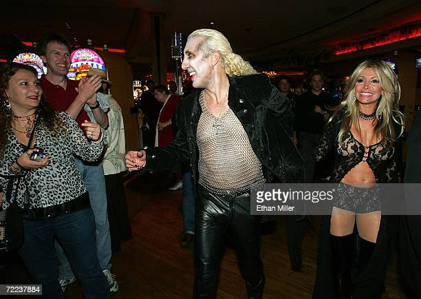 Twisted Sister singer Dee Snider and his wife Suzette are greeted by fans as they walk through the Hard Rock Hotel Casino after their wedding vow...