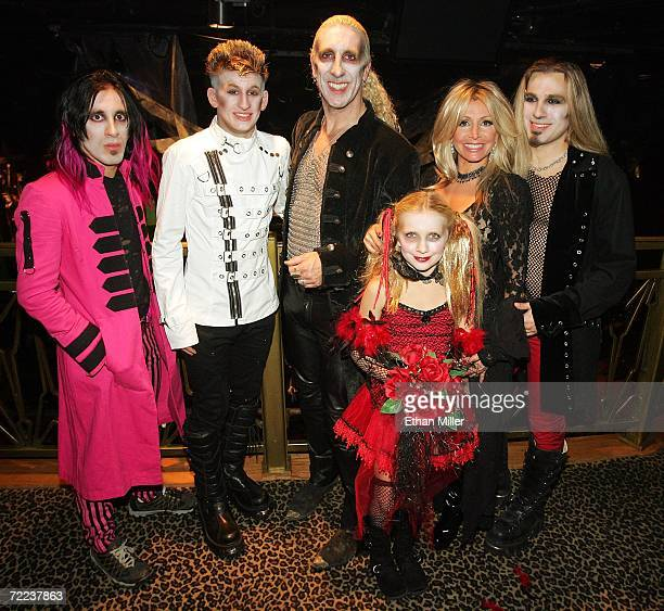 Twisted Sister singer Dee Snider and his wife Suzette pose backstage with their children Shane Snider Cody Snider Cheyenne Snider and Jesse Blaze...