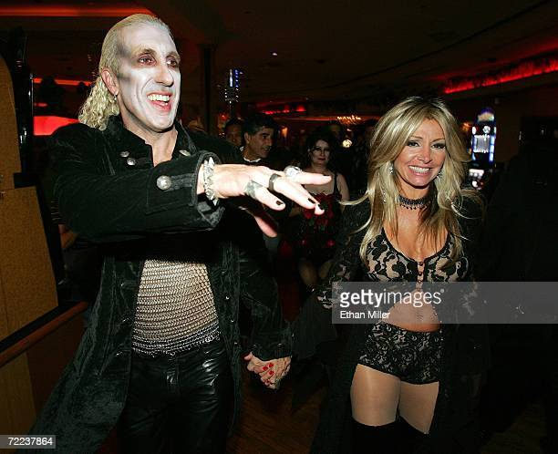 Twisted Sister singer Dee Snider and his wife Suzette walk through the Hard Rock Hotel Casino after their wedding vow renewal ceremony following a...