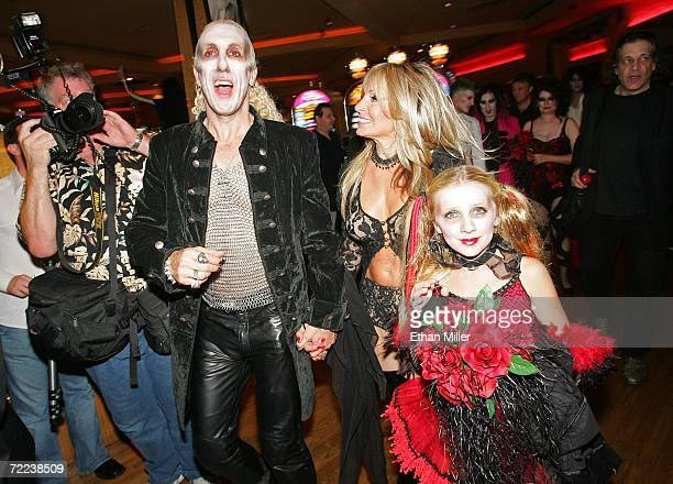 Twisted Sister singer Dee Snider his wife Suzette and their daughter Cheyenne Snider walk through the Hard Rock Hotel Casino after the couple's...