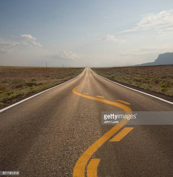 twisting line marking on road - twisted stock pictures, royalty-free photos & images