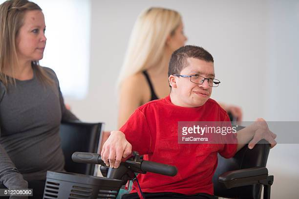 twisting to stretch their lower back - quadriplegic stock photos and pictures