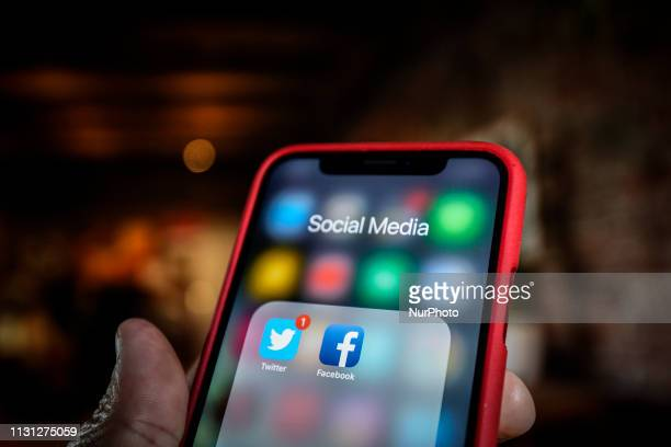 Twitter and Facebook applications are seen grouped in a Social Media folder on an iPhone in this photo illustration on March 17 2019 in Warsaw Poland
