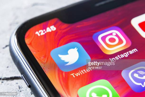 twitter and instagram apps in iphone xr, close up - social issues stock pictures, royalty-free photos & images