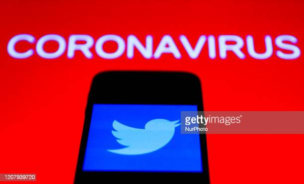 Twitter app icon is seen on the smartphone screen with coronavirus sign in the background in this illustration photo taken in Poland on March 21 2020