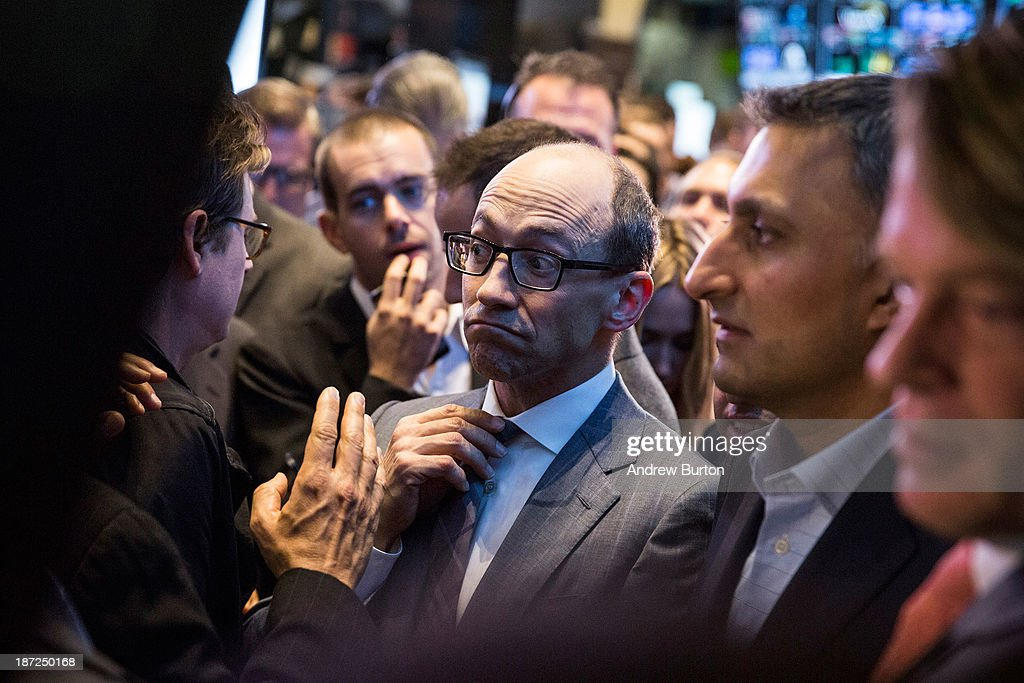 Twitter CEO Dick Costolo adjusts his tie while waiting to see what Twitter's opening market price will be on the floor of the New York Stock Exchange (NYSE) on November 7, 2013 in New York City. Twitter went public November 7, on the NYSE selling at a market price of $45.10, with the initial price being set at $26 on November 6.