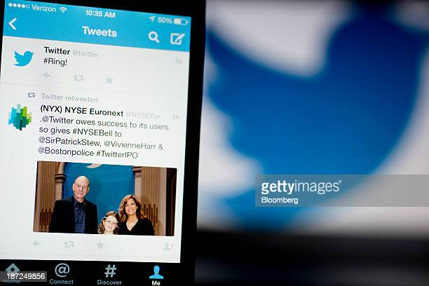 A Twitter Inc tweet regarding the company ringing the opening bell on the New York Stock Exchange is displayed on an Apple Inc iPhone arranged for a...