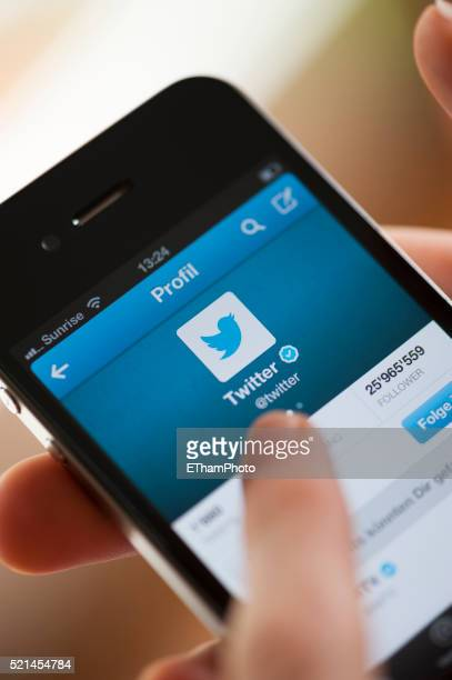 twitter on iphone - online messaging stock pictures, royalty-free photos & images