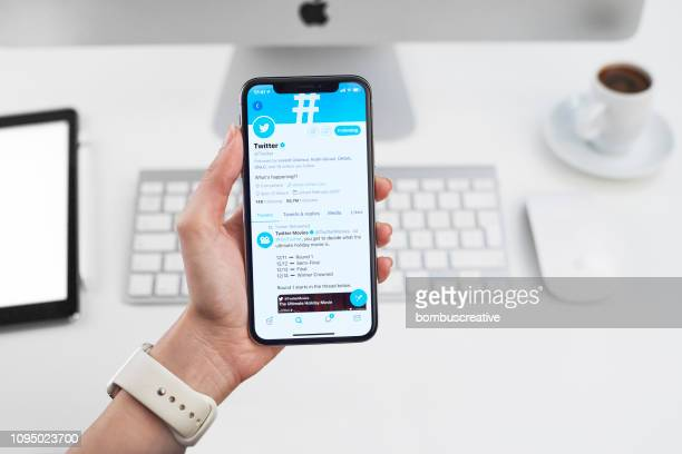 twitter profile on apple iphone x - twitter stock pictures, royalty-free photos & images