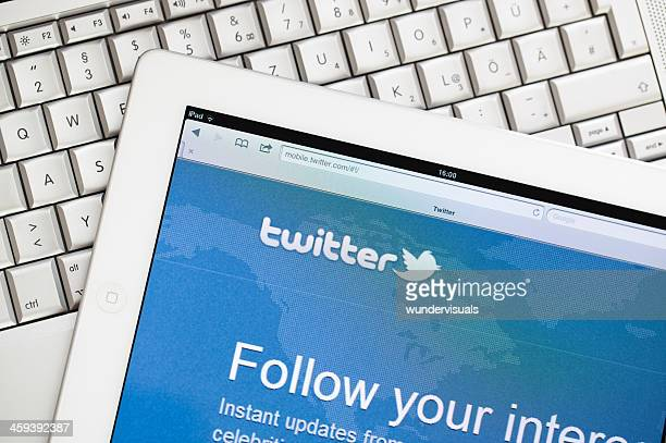 twitter website on apple ipad2 - twitter stock pictures, royalty-free photos & images