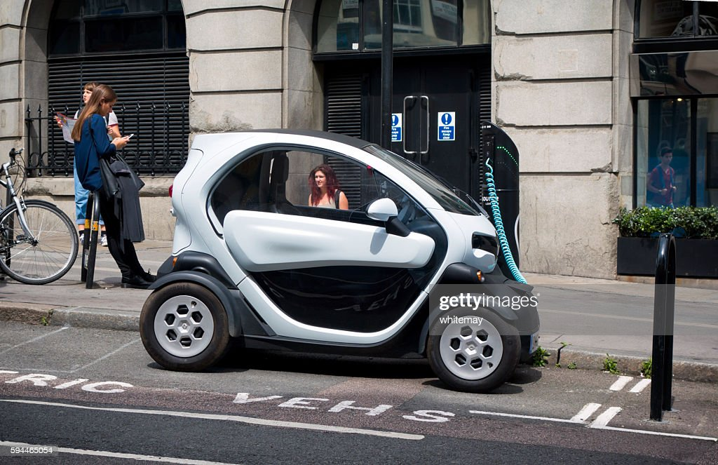 Twizy electric city car recharging in a London street : Stock Photo