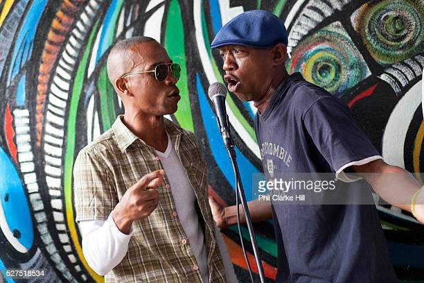 Two 2 Cuban men singing. Callejon de Hamel, a street art project in old Havana, which has a Rumba show on a Sunday afternoon, and has strong links to...