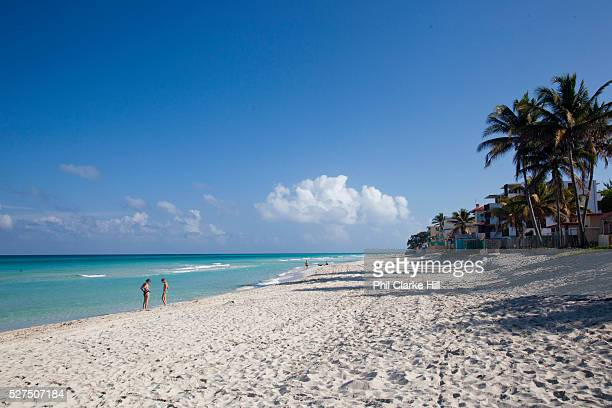 Two 2 people on Varadero beach in Matanzas province Cuba's most popular beach resort welcoming thousands of guests every year from all over the world