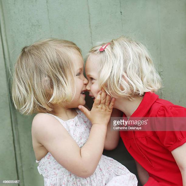 two 3 years old twins girls playing together - 2 3 years stock pictures, royalty-free photos & images