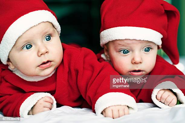 Two 5 month baby brothers dressed us as little santas