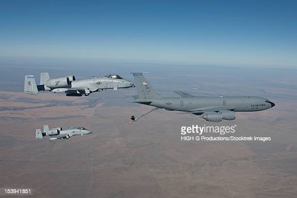 Two A-10 Thunderbolt's from the 124th Fighter Wing join up with a KC-135 to conduct aerial refueling training over Central Idaho.