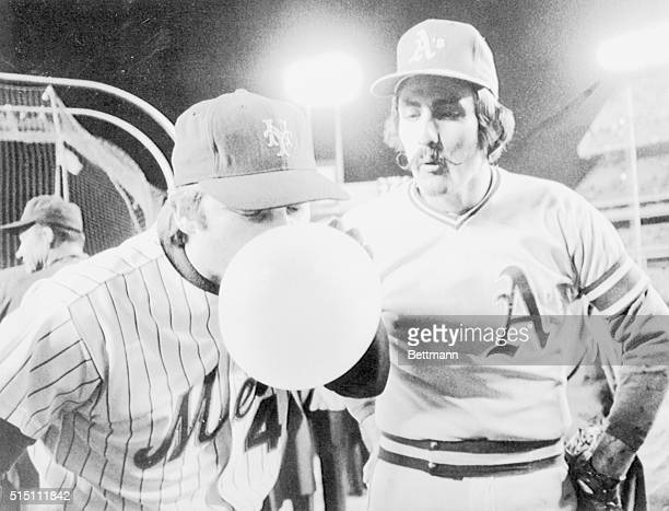 Two ace relievers get a bit of relief from the World Series tension prior to 1016 game here as Mets' ace Tug McGraw blows huge bubblegum bubble under...