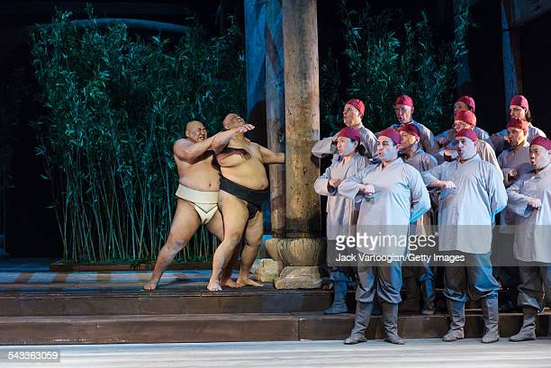 Two actors and sumo wrestlers Mongolian Byamba Ulambayar and American Americus Abesamis perform in a scene from Act II of the final dress rehearsal...