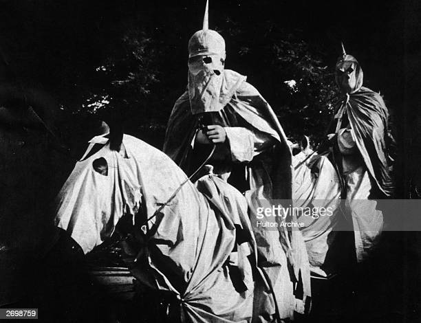 Two actors playing Ku Klux Klansmen riding hooded horses in a scene from D W Griffith's 'Birth of a Nation'