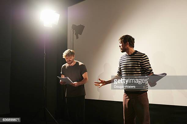 two actors rehearsing on stage. - schauspieler stock-fotos und bilder