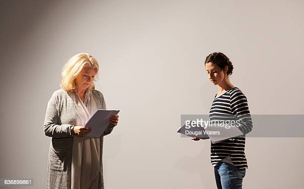 two actresses rehearsing script. - actress stock pictures, royalty-free photos & images