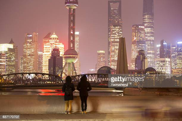 Two adauts looking at the Shanghai city night