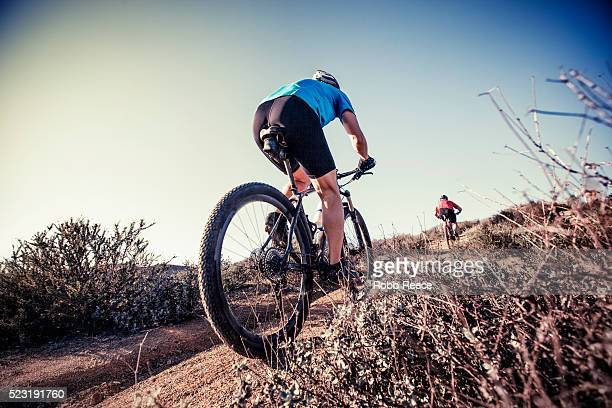 two adult men riding mountain bikes up on a steep trail on a hill in california - robb reece bildbanksfoton och bilder