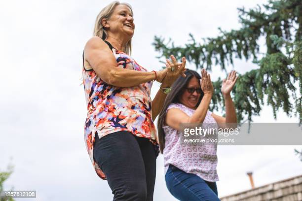 two adult senior female friends having fun together outdoors - eyecrave  stock pictures, royalty-free photos & images