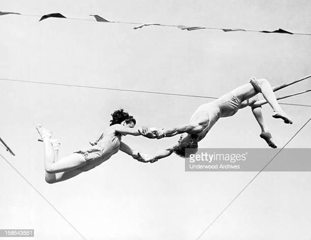 Two aerial artists for the Ringling Brothers and Barnum and Bailey Circus start limbering up for the summer circuit, Sarasota, Florida, March 13,...