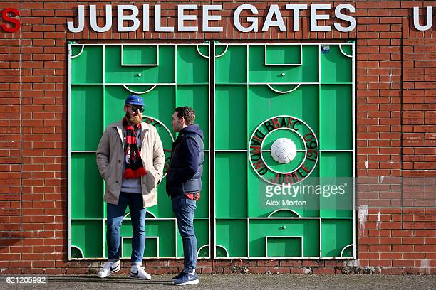 Two AFC Bournemouth fans speak outside the stadium prior to kick off during the Premier League match between AFC Bournemouth and Sunderland at...
