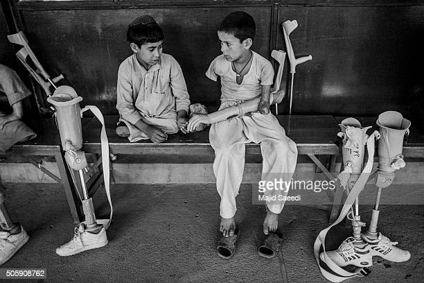 Two Afghan amputee boys at the Red Cross Center in Kabul