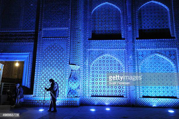 Two Afghan beggars stand outside the walls of the ancient Blue Mosque as Afghans go about daily life despite security fears of a resurgent Taliban on...