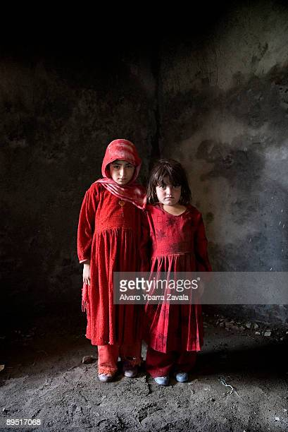 Two Afghan girls called Hakema and Talima pose for a portrait These little girls are the future of Afghanistan however they don't have much hope and...