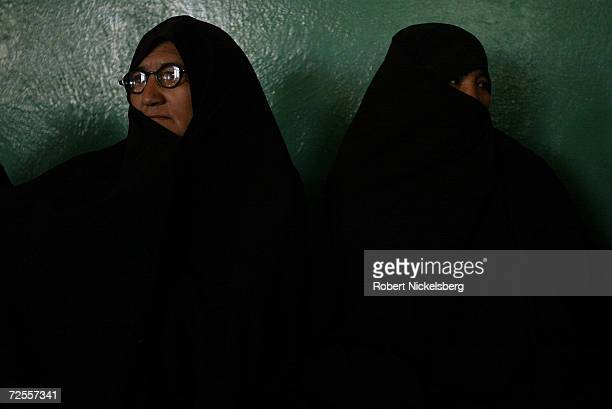 Two Afghan women sit and listen to Afghan presidential candidate Dr Masuda Jalal at a political campaign gathering on September 29 in Kabul...