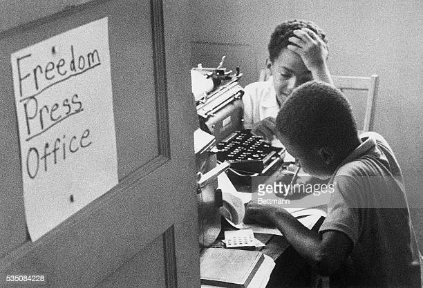 Two African American boys work in the Freedom Press Office in Hattiesburg Mississippi for the Mississippi Project a campaign to increase black voter...