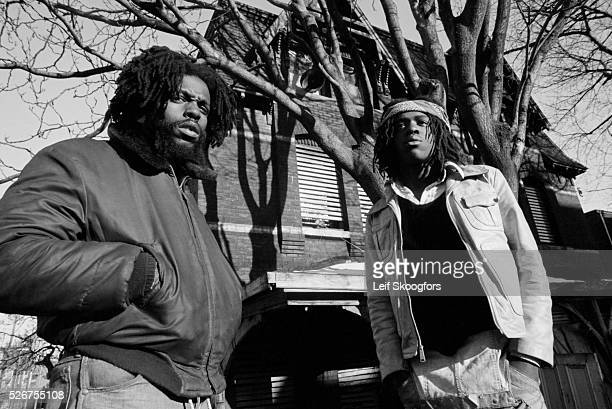 Two African American member of MOVE a cult founded by John Africa stand in front of their barricaded house in the Powelton Village section of...
