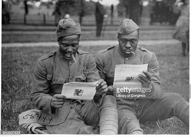 Two African American soldiers read a Red Cross publication in Hyde Park London ca 19191920