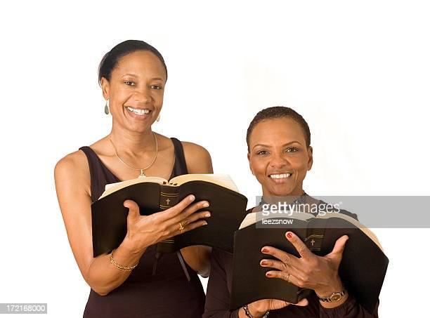 Two African American Women Reading Bibles