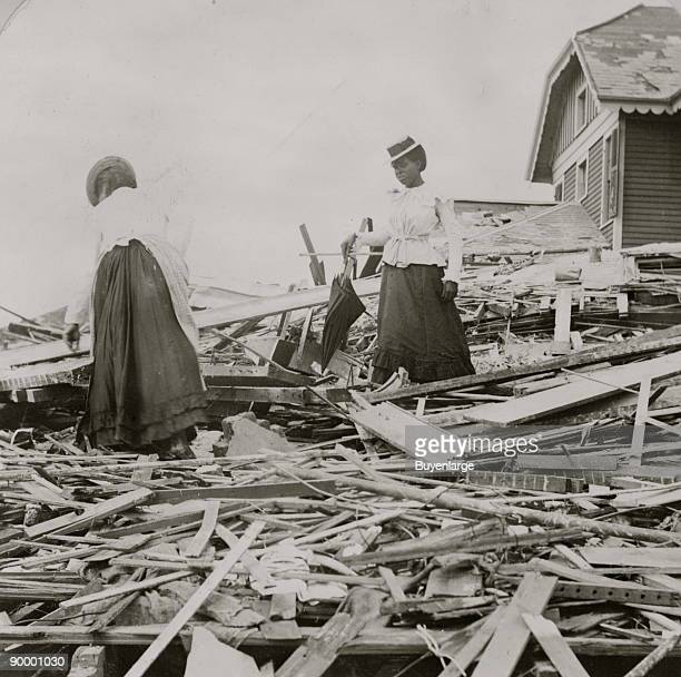 Two African American women search through rubble following a violent hurricane which devastated most of Galveston and took more than 5000 lives