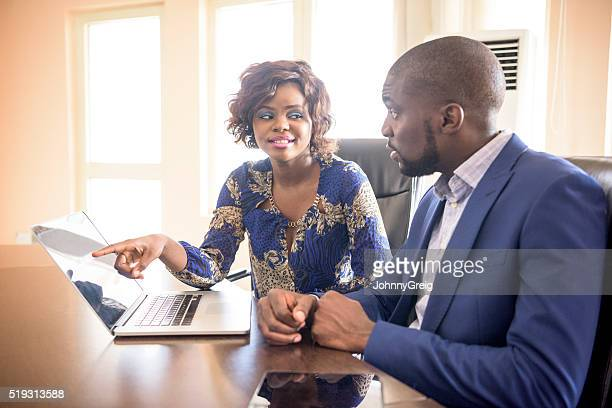 Two African business colleagues meeting in modern office