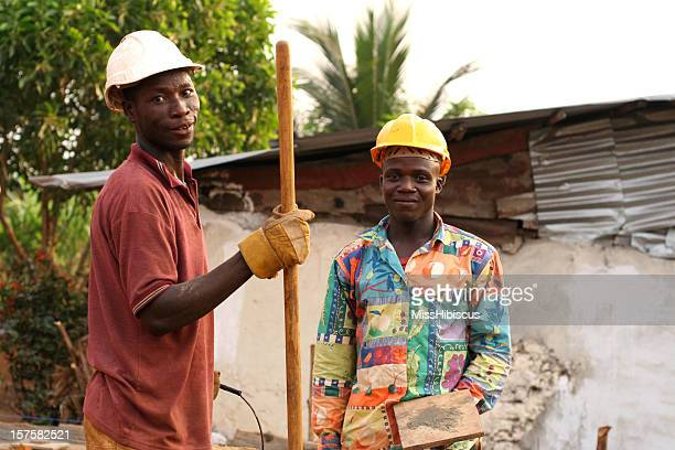 two african men on a construction site of a house - liberia stock pictures, royalty-free photos & images