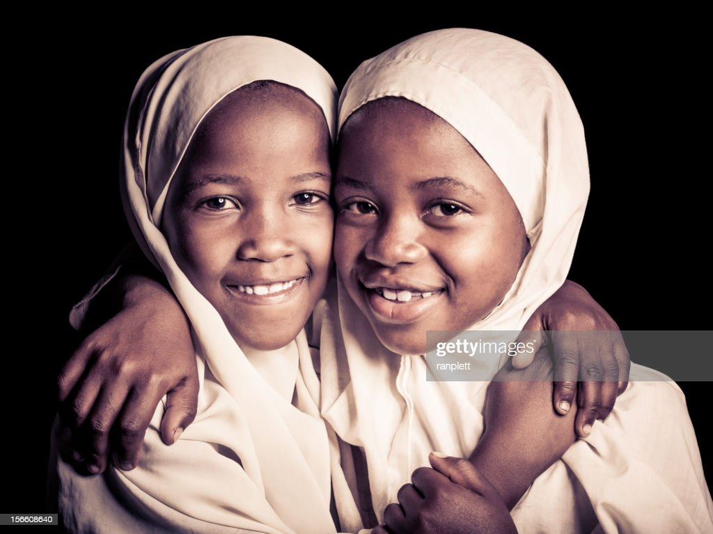 Two African Muslim Girls (Isolated on Black) : Stock Photo