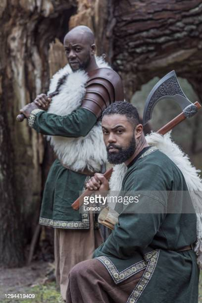 two african warriors guards in a forest - historical clothing stock pictures, royalty-free photos & images